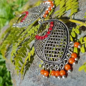 These pretty earrings will look really beautiful hanging from your ears. The design is quite unusual and you may not see any others like this around. Also, very detailed in design.